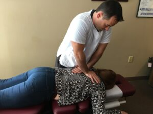 Dr. Nutche making an adjustment on a patient